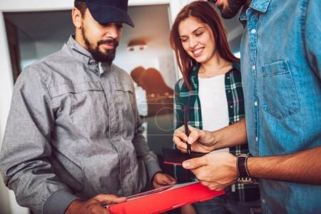 woman and male receiving Pizza Delivery