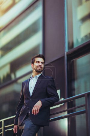 Photo for Portrait of a young happy businessman outside the office building - Royalty Free Image