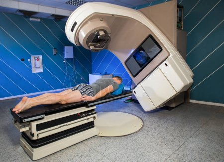 Man Receiving Radiation Therapy for Cancer In The Hospital