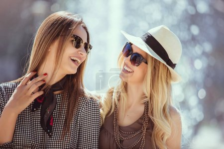 Happy women talking and laughing, having fun outdoor.