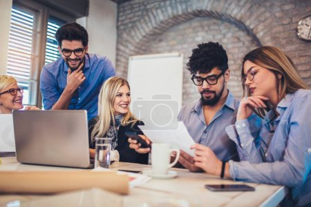 Photo for Group of young business people in smart casual wear working together in creative office - Royalty Free Image