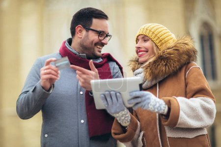 Photo for Young couple using a digital tablet for on line shopping. - Royalty Free Image