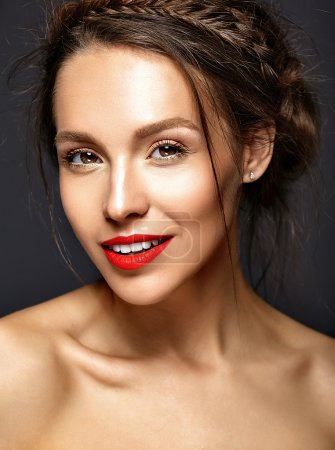 Portrait of beautiful woman model with fresh daily makeup and red lips and healthy skin