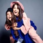 Fashion portrait of two smiling brunette women mod...