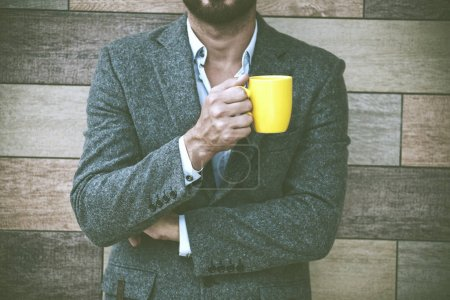 businessman hand holding coffee