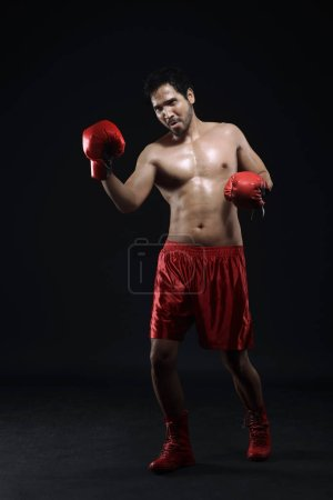 Portrait of asian guy boxer is celebrating his winning
