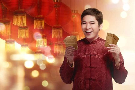 Chinese man holding angpaos