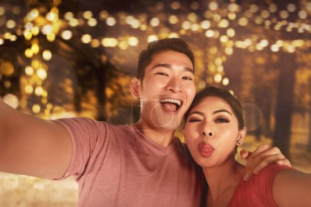 Young couple making selfie photo