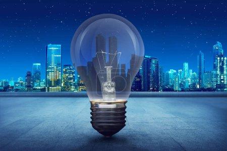 Light bulb on building balcony on city