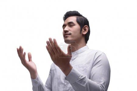 asian muslim man praying to god