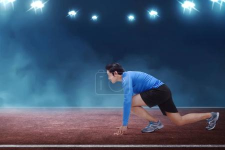 asian runner man kneeling