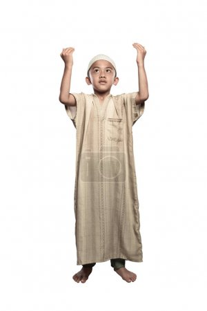 Portrait of asian muslim kid with cap praying