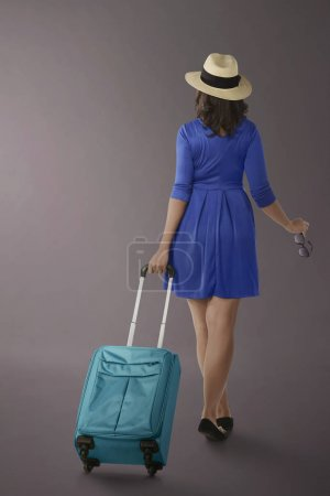 woman traveling with suitcase
