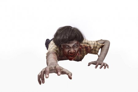 Portrait of asian undead man crawling