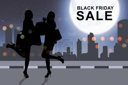 Silhouette woman shopping with paperbag on Black Friday