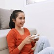 Asian woman playing video games