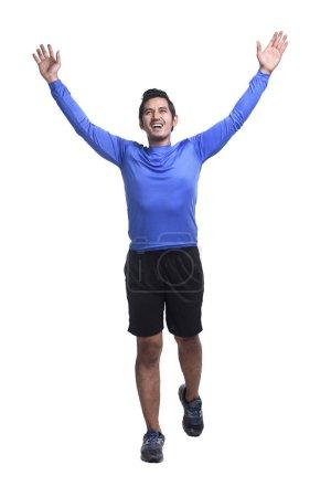 Young asian man running