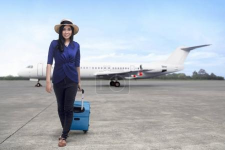 Asian woman going traveling with suitcase