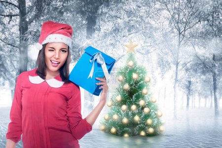 woman with Santa hat holding gift box
