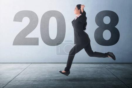 business woman running at 2018