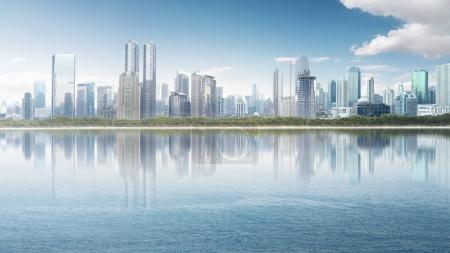 Modern cityscape with skyscraper building and reflection from the river