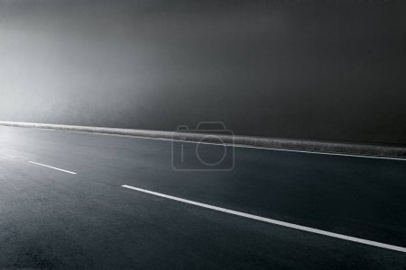 Asphalt road tunnel with stripes without traffic