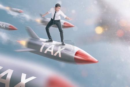 Handsome asian businessman flying on rocket