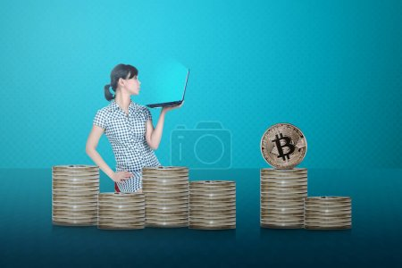 Side view of asian businessman with laptop sitting with bitcoin stacks. Blockchain technology concept