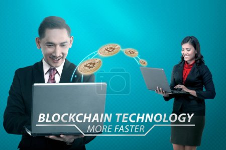Two asian business people transferring virtual money with laptop. Blockchain Technology Concept