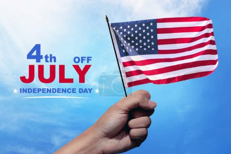 Hands with waving american flag on the sky. Happy Independence Day