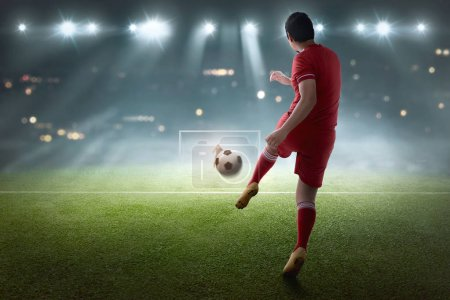 Photo for Young asian soccer player shooting the ball on the match - Royalty Free Image