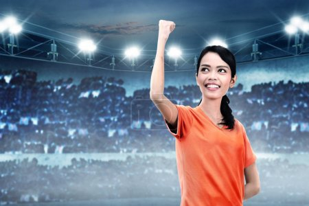 asian soccer player woman after win match on stadium
