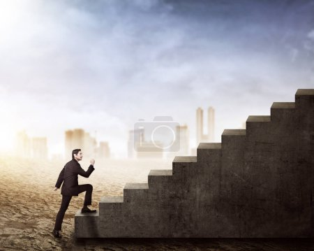 Side view of asian businessman walking up stairs on the dry land