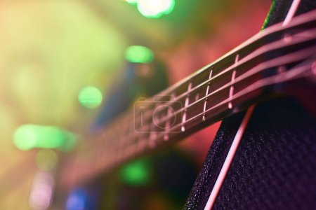Photo for Closeup of guitar fingerboard at concert in light - Royalty Free Image