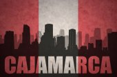 abstract silhouette of the city with text Cajamarca at the vintage peruvian flag