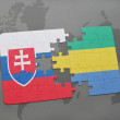 Постер, плакат: Puzzle with the national flag of slovakia and gabon on a world map