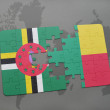 Постер, плакат: Puzzle with the national flag of dominica and benin on a world map