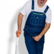 Worker in overalls clutching his groin in discomfo...