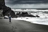 Tourist on Freshwater Rocks Beach California Pacific Coast