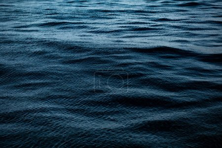Photo for Blue water surface with waves and ripples - Royalty Free Image