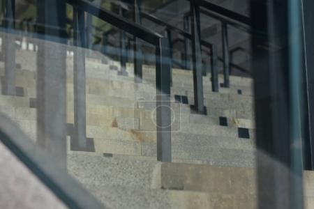 Staircase with glass metal handrails