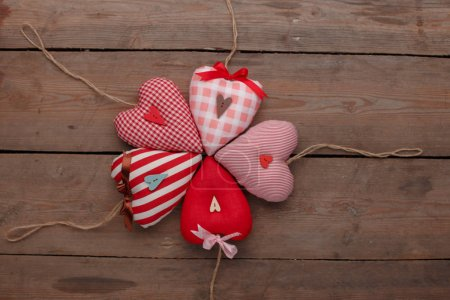 Photo for Happy Valentines Day love celebration in a rustic style isolated. Hearts on wooden background. - Royalty Free Image