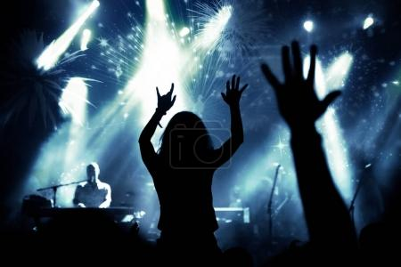 Photo for New Year concept - cheering crowd and fireworks - Royalty Free Image