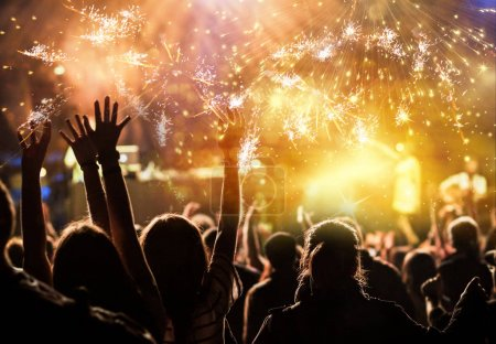 Photo for Cheering crowd watching fireworks - new year concept - Royalty Free Image