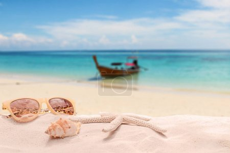 Photo for Summer vacation concept with accessories on sandy beach - Royalty Free Image