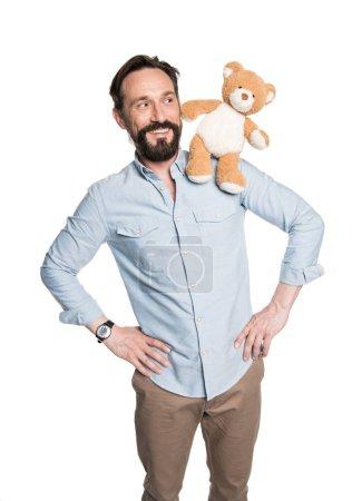 Bearded man with teddy bear