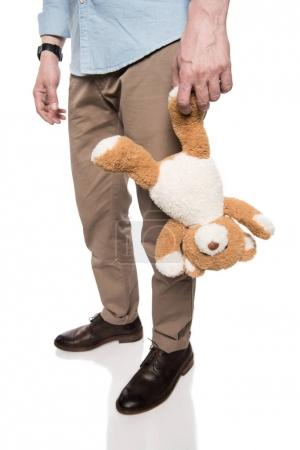 Casual man holding teddy bear