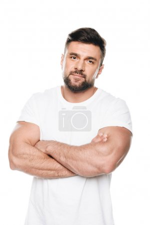 Photo for Portrait of confident bearded man posing with arms crossed and looking at camera isolated on white - Royalty Free Image