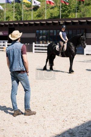 couple riding horse