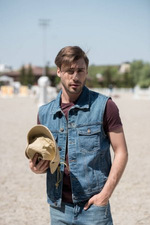 handsome man with cowboy hat